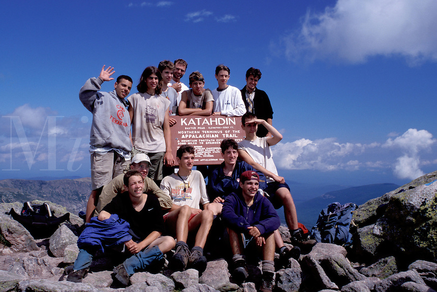 Appalachian Trail, Mt. Katahdin, Maine, Baxter Park, ME, backpacking, Hikers posing for picture at the Terminus of the Appalachian Trail on Mt. Katahdin in Baxter State Park.