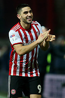 Neal Maupay, scorer of Brentford's winning stoppage time goal, celebrates at the final whistle during Brentford vs Aston Villa, Sky Bet EFL Championship Football at Griffin Park on 13th February 2019