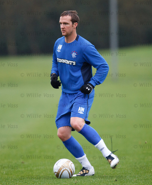 Andy Webster with his laces undone at training