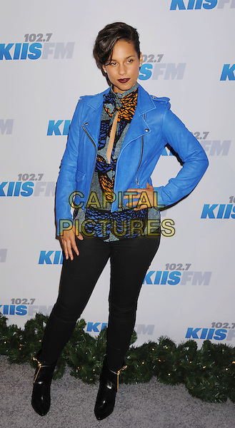 Alicia Keys .The KIIS FM's Jingle Ball 2012 held at Nokia Theatre L.A. Live in Los Angeles, California, USA..December 3rd, 2012.full length blue jacket leather orange print black jeans denim ankle boots hand on hip.CAP/ROT/TM.©Tony Michaels/Roth Stock/Capital Pictures