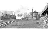 D&amp;RGW #483 steaming up in Durango yard.  Experimental car &amp; engine washer near the water tank.<br /> D&amp;RGW  Durango, CO  1964