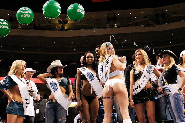 The Wingettes have their own competition and display their own special talents after the eating contestat the 13th annual Wing Bowl, held in Philadelphia on February 4, 2005 at the Wachovia Center.<br /> <br /> The Wing Bowl is a competitive eating event in which eaters try and down the most hot wings in 30 total minutes in front of a crowd of 10,000 plus people.  The real show however is all around the eaters, from the various scantily clad women, known as &quot;Wingettes&quot;, that make up competitors' entourages to the behavior of the fans themselves.