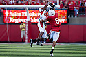 26 September 2009: Louisiana-Lafayette tight end Ladarius Green makes a catch for  32 yards and a first down in the first quarter. Nebraska cornerback Anthony West making the stop at Memorial Stadium, Lincoln, Nebraska. Nebraska defeats Louisiana Lafayette 55 to 0.