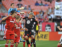 Joseph Bendik (12) of Toronto FC goes up to make a save. Toronto FC defeated D.C. United 2-1, at RFK Stadium, Saturday June 15 , 2013.