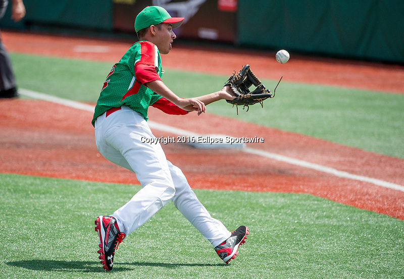 Aberdeen, MD - JULY 31: David Guevara #12 of Mexico fields a ground ball during the game between the Republic of Korea and Mexico during the Cal Ripken World Series at The Ripken Experience Powered by Under Armour on July 31, 2016 in Aberdeen, Maryland. (Photo by Ripken Baseball/Eclipse Sportswire/Getty Images)