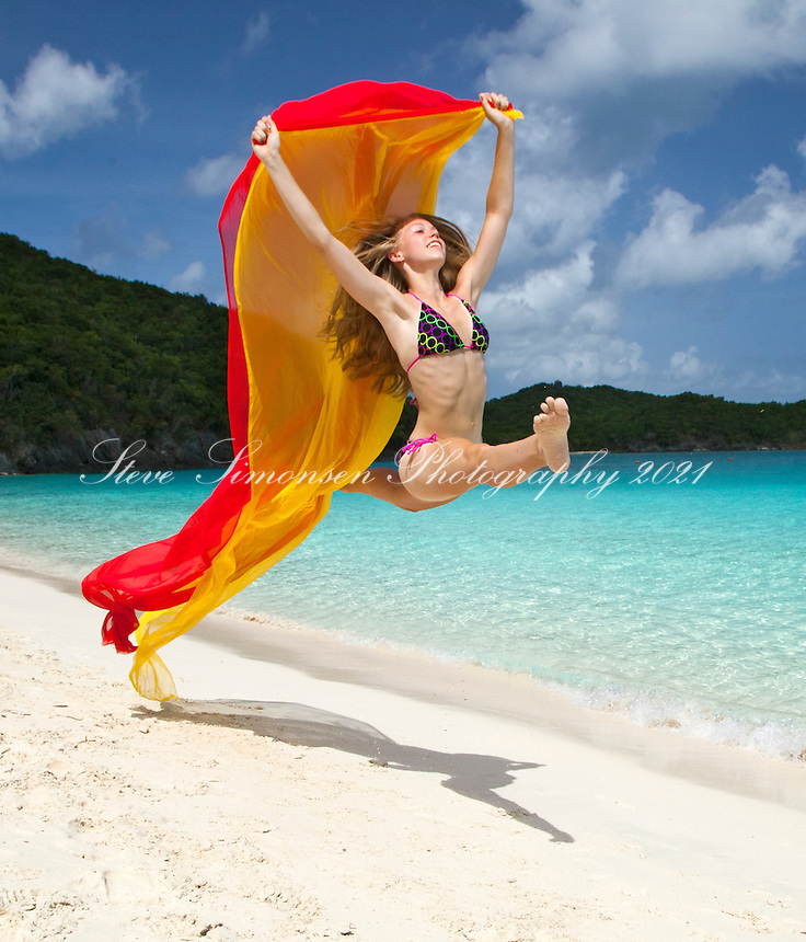 Alex Krasny former gymnast running with red scarf.Trunk Bay.Virgin Islands National Park.St. John.U.S. Virgin Islands
