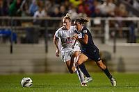 Sky Blue FC forward Lisa De Vanna (11) is marked by FC Kansas City defender Lauren Sesselmann (14). FC Kansas City defeated Sky Blue FC 1-0 during a National Women's Soccer League (NWSL) match at Yurcak Field in Piscataway, NJ, on July 28, 2013.