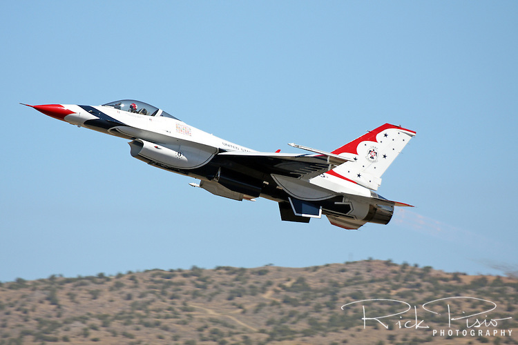 The United States Air Force Thunderbirds Opposing Solo aircraft, #6, utilizes its afterburner to get airborne during a flight demonstration at the 2008 Reno National Championship Air Races at Stead Field in Nevada. The Thunderbirds were formed in 1956 and have been flying the F-16C Fighting Falcon since 1992.