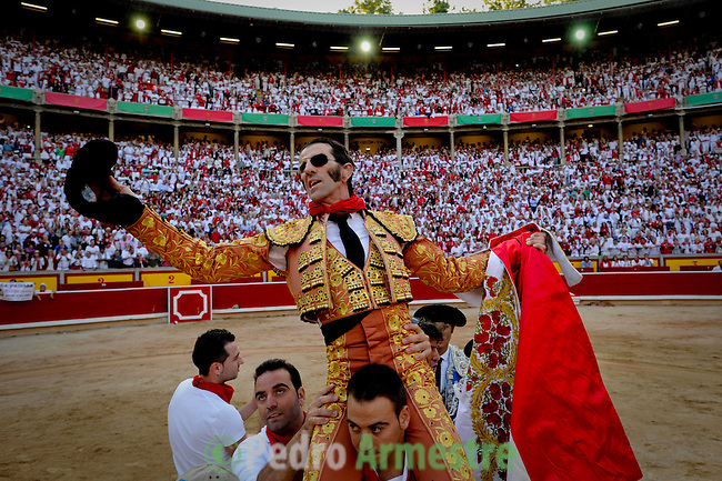 Matadors Juan Jose Padilla celebrates after cutting three bull ears during the San Fermin festival, on July 14, 2012, in the Northern Spanish city of Pamplona. The festival is a symbol of Spanish culture that attracts thousands of tourists to watch the bull runs despite heavy condemnation from animal rights groups. (c) Pedro ARMESTRE