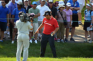 Bethesda, MD - June 29, 2014: Patrick Reed points to his ball in the water ditch during the Final Round of the Quicken Loans National at the Congressional Country Club in Bethesda, MD, June, 29, 2014. Reed double-bogeyed after sitting atop the Leaderboard at the start of the round. (Photo by Don Baxter/Media Images International)