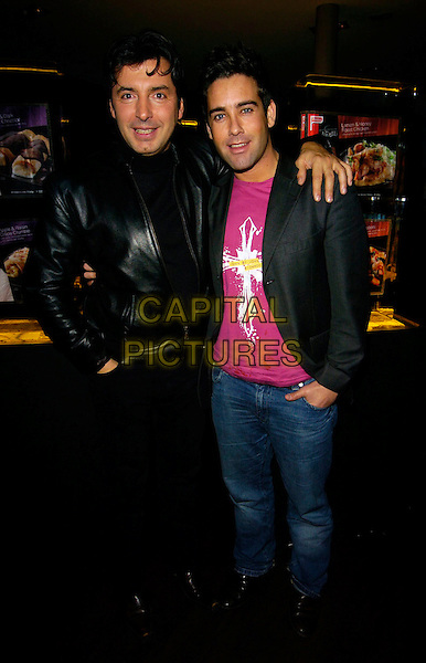 JEAN CHRISTOPHE NOVELLI & GILES VICKER JONES.Jean-Christophe Novelli's Findus Food Range Launch, Absolut Ice Bar, London, UK..January 24th, 2007.full length black leather jacket suit jeans denim arm over shoulder .CAP/CAN.©Can Nguyen/Capital Pictures