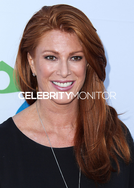 SANTA MONICA, CA, USA - JUNE 11: Angie Everhart at the Pathway To The Cures For Breast Cancer: A Fundraiser Benefiting Susan G. Komen held at the Barker Hangar on June 11, 2014 in Santa Monica, California, United States. (Photo by Xavier Collin/Celebrity Monitor)