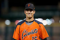 Ricardo Genoves (15) of the AZL Giants walks to the dugout after warming up Nick Hill (not pictured) between innings during Game Three of the Arizona League Championship Series against the AZL Cubs on September 7, 2017 at Scottsdale Stadium in Scottsdale, Arizona. AZL Cubs defeated the AZL Giants 13-3 to win the series two games to one. (Zachary Lucy/Four Seam Images)