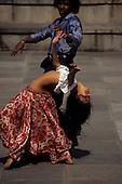 Recife, Brazil. Couple dancing in a city square; Pernambuco State.