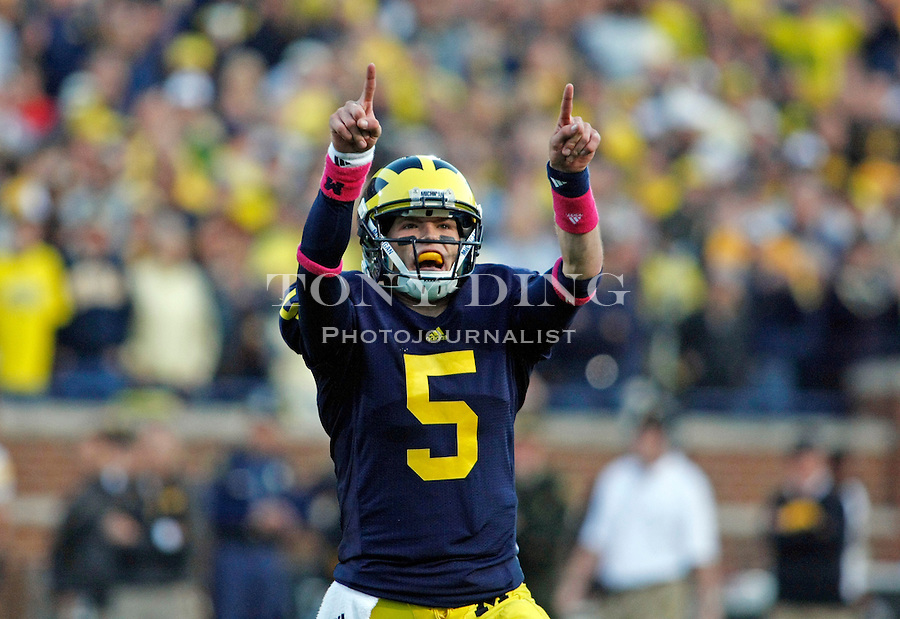 Michigan quarterback Tate Forcier (5) celebrates a 31-yard pass to Iowa's three yard line in the fourth quarter of an NCAA college football game, Saturday, Oct. 16, 2010, in Ann Arbor, Mich. Iowa won 38-28. (AP Photo/Tony Ding)