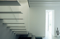 View of the cantilevered staircase as it descends into the living area