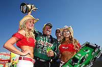 Aug. 3, 2014; Kent, WA, USA; NHRA funny car driver John Force celebrates (center) celebrates after winning the Northwest Nationals at Pacific Raceways. Mandatory Credit: Mark J. Rebilas-USA TODAY Sports