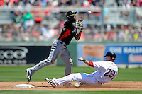 Miami Marlins shortstop Adeiny Hechavarria #3 attempts to turn a double play as Daniel Nava #29 slides in during a Spring Training game against the Boston Red Sox at JetBlue Park on March 27, 2013 in Fort Myers, Florida.  Miami defeated Boston 5-1.  (Mike Janes/Four Seam Images)