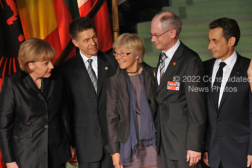 Baden-Baden, Germany - April 4, 2009 -- Heads of State and Government arrive at the NATO Summit in Baden-Baden, Germany on Saturday, April 4, 2009.   From left to right: Angela Merkel, Chancellor of the Federal Republic of Germany and her husband; Herman Van Rompuy, Prime Minister of Belgium and his wife; Nicholas Sarkozy, President of France..Mandatory Credit: NATO via CNP