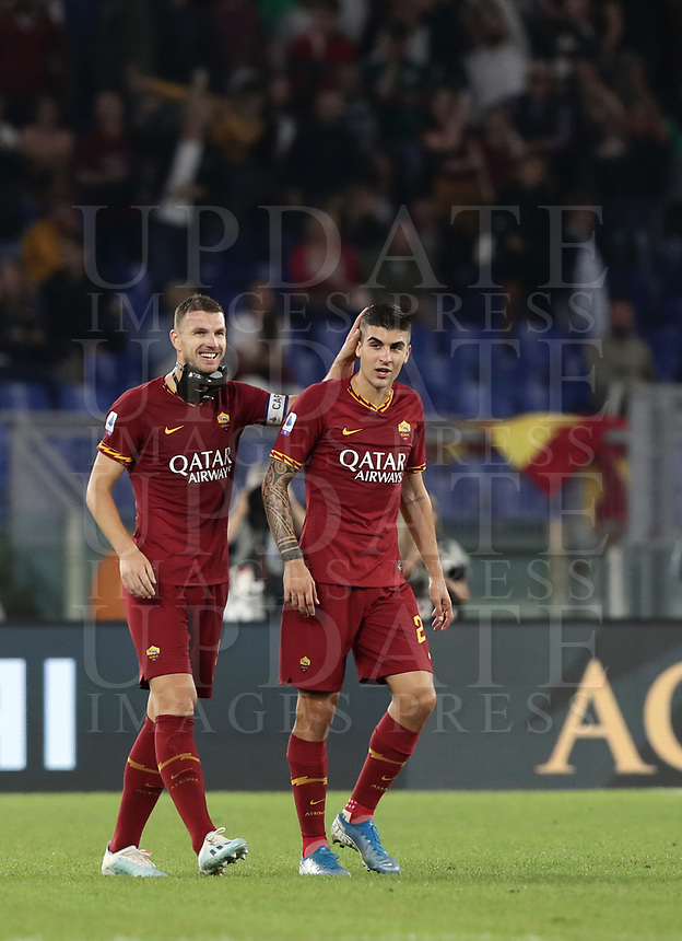 Football, Serie A: AS Roma - AC Milan, Olympic stadium, Rome, October 27, 2019. <br /> Roma's captain Edin Dzeko (l) celebrates after scoring with his teammate Gianluca Mancini (r) during the Italian Serie A football match between Roma and Milan at Olympic stadium in Rome, on October 27, 2019. <br /> UPDATE IMAGES PRESS/Isabella Bonotto