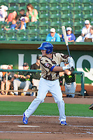 Colin Hering (28) of the Ogden Raptors at bat against the Great Falls Voyagers in Pioneer League action at Lindquist Field on July 17, 2014 in Ogden, Utah.  (Stephen Smith/Four Seam Images)