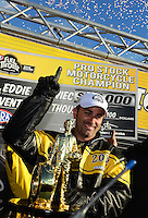 Nov. 10, 2012; Pomona, CA, USA: NHRA pro stock motorcycle rider Eddie Krawiec celebrates after clinching the 2012 world championship during qualifying for the Auto Club Finals at at Auto Club Raceway at Pomona. Mandatory Credit: Mark J. Rebilas-