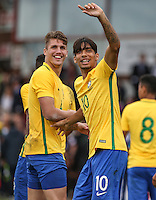 Goalscorer Lucas Paqueta (right) of Brazil celebrates at full time but appears to injury himself in the process during the International match between England U20 and Brazil U20 at the Aggborough Stadium, Kidderminster, England on 4 September 2016. Photo by Andy Rowland / PRiME Media Images.