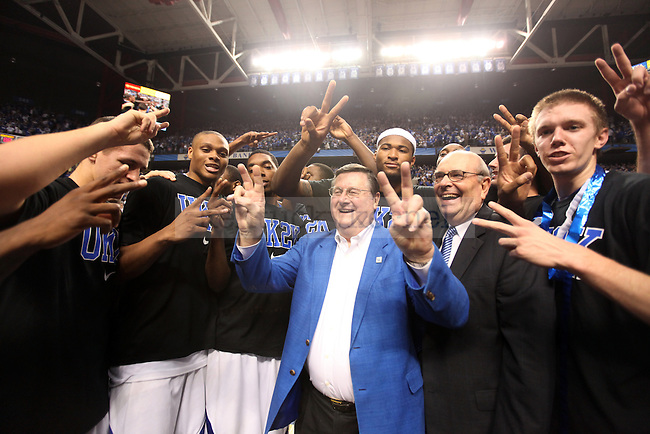 The UK men's basketball team celebrates with former coach Joe B. Hall after UK's 2,000th win against Drexel at Rupp Arena on Monday, Dec 21, 2009. Photo by Britney McIntosh | Staff