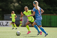 Seattle, WA - Sunday, May 22, 2016: Seattle Reign FC forward Merritt Mathias (9) watches Chicago Red Stars defender Julie Johnston (8) during a regular season National Women's Soccer League (NWSL) match at Memorial Stadium. Chicago Red Stars won 2-1.