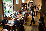 A waiter servers the diners during lunch at the Age and Sons restaurant in Ramsgate, United Kingdom.