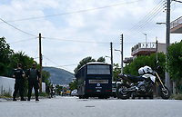 Pictured: Police prsencel in Acharnes, Athens, Greece. Friday 09 June 2017<br /> Re: An 11 year old boy has been shot dead by a &quot;stray bullet&quot; during a school celebration in Acharnes (Menidi) area, in the outskirts of Athens, Greece.<br /> Marios Dimitrios Souloukos &quot;complained to his mum&quot; who works as a teacher at the 6th Primary School of Acharnes that he was feeling unwell, he then collapsed with blood pouring out from the top of his head.<br /> His mum tried to revive him assisted by other teachers while his schoolmates who were reportedly upset, were hurriedly removed by their parents.<br /> According to locals an ambulance arrived 25 minutes late.<br /> Hundreds of police officers have been deployed in the area and have raided many properties.<br /> Shells matching the fatal bullet which hit the boy on the top of his head were found in a house yard nearby.<br /> Local people reported hearing shots being fired at a nearby Romany Gypsy camp before the fatal incident.<br /> The area has been plagued with criminality during the last few years.