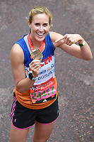 Helen Glover<br /> carried away by St John's Ambulance at the finish line on The Mall at the 2017 London Marathon, London. <br /> <br /> <br /> ©Ash Knotek  D3254  23/04/2017