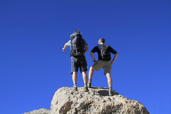 Two Caucasian on the summit of Mount Evans (14250 feet) in the Rocky Mountains west of Denver, Colorado, USA