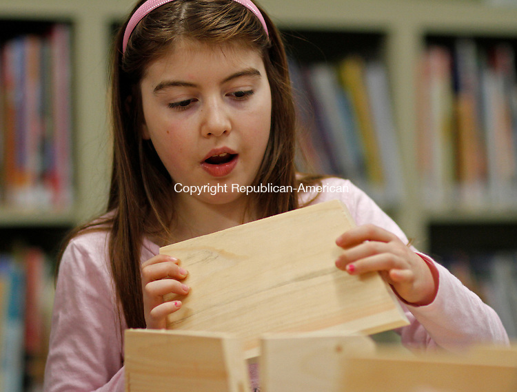 Bridgewater, CT-011114MK20 COUNTRYLIFE Caitlin Murphy assembles a bird house at the Burnham Junior Library workshop on Saturday morning in Bridgewater.    Michael Kabelka / Republican-American