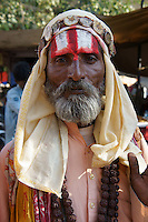 Holy man on pilgrimage for Kartik Purnima (eight full moon of the year) to bath in Pushkars sacred lake  in Pushkar, Rajastan, India
