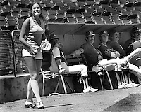 Oakland A's ball girl Debbie Sivyer in front of the A's bull pen, later she became Mrs. Fields of cookie fame..(1970's photo by Ron Riesterer)