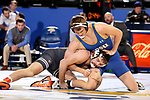 BROOKINGS, SD - NOVEMBER 17: Logan Peterson from South Dakota State University battles with Chandler Rogers from Oklahoma State University during their 165 pound match Saturday night at Frost Arena in Brookings. (Photo by Dave Eggen/Inertia)