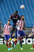 Atletico de Madrid´s Arda Turan (R) and Olympiacos´s Masuaku during Champions League soccer match between Atletico de Madrid and Olympiacos at Vicente Calderon stadium in Madrid, Spain. November 26, 2014. (ALTERPHOTOS/Victor Blanco) /NortePhoto