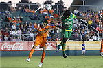 14 September 2013: Tampa Bay's Lucky Mkosana (ZIM) (71) heads over Carolina's Kupono Low (left). The Carolina RailHawks played the Tampa Bay Rowdies at WakeMed Stadium in Cary, North Carolina in a North American Soccer League Fall 2013 Season regular season game. The game ended in a 2-2 tie.