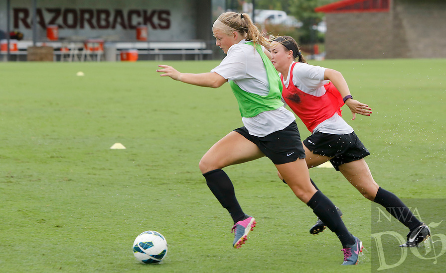 NWA Democrat-Gazette/DAVID GOTTSCHALK   University of Arkansas Razorback soccer player Ashleigh Ellenwood (left) during practice Wednesday, August 19, 2015 on the campus in Fayetteville.