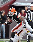 Landover, MD - October 19, 2008 -- Cleveland Browns running back Jamal Lewis (31) runs over Washington Redskins cornerback Fred Smoot (27) in first quarter action at FedEx Field in Landover, Maryland on Sunday, October 19, 2008..Credit: Ron Sachs / CNP