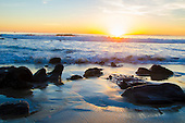 Stock photo of Sun setting at Laguna Beach