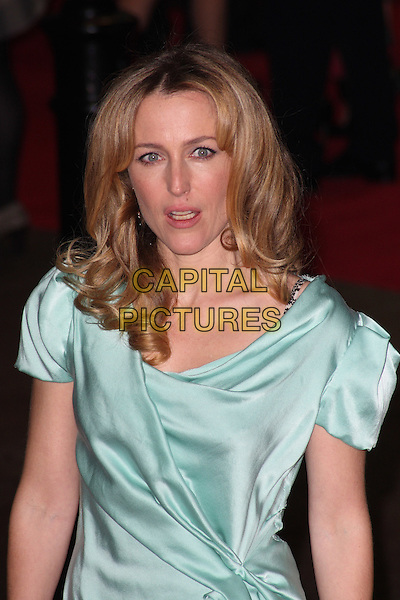 GILLIAN ANDERSON.'Never Let Me Go' Opening Gala of the London Film Festival at the Odeon, Leicester Square, London, England..October 13th 2010.half length dress wrap green turquoise silk satin .CAP/JIL.©Jill Mayhew/Capital Pictures