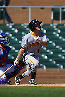 Glendale Desert Dogs shortstop Adam Frazier (12) at bat during an Arizona Fall League game against the Surprise Saguaros on October 23, 2015 at Salt River Fields at Talking Stick in Scottsdale, Arizona.  Glendale defeated Surprise 9-6.  (Mike Janes/Four Seam Images)