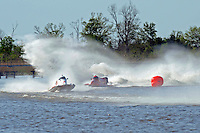 Frame 10: Terry Rinker (#10) and Chris Fairchild (#62) race up the back stright to turn 2 where Rinker's boat rolls over a wake, noses in and flips.   (Formula 1/F1/Champ class)