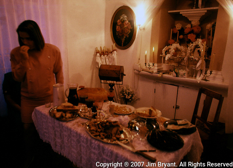 A young woman samples meat, cheese, wine, olives and bread inside an imperios on Terceira, Azores. Far out in the Atlantic Ocean, some 850 miles off the western coast of Lisbon, Portugal lies the 425-mile long archipelago of the Azores. (Jim Bryant Photo).....