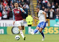 Cardiff City's Lee Peltier passes despite the attentions of Burnley's Dwight McNeil<br /> <br /> Photographer Rich Linley/CameraSport<br /> <br /> The Premier League - Saturday 13th April 2019 - Burnley v Cardiff City - Turf Moor - Burnley<br /> <br /> World Copyright © 2019 CameraSport. All rights reserved. 43 Linden Ave. Countesthorpe. Leicester. England. LE8 5PG - Tel: +44 (0) 116 277 4147 - admin@camerasport.com - www.camerasport.com
