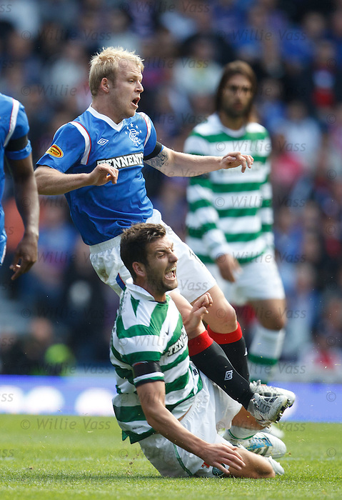 Charlie Mulgrew goes straight through Steven Naismith for his first booking of the match