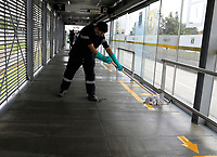 """BOGOTA, COLOMBIA - March 13:  A worker cleans a public transportation station of """"Transmilenio"""" on March 13, 2020 in Bogota, Colombia. The World Health Organization declared a global pandemic as the coronavirus rapidly spreads across the world. Colombian President Ivan Duque declared a health emergency to contain an outbreak of coronavirus, suspending public events with more than 500 people. (Photo by John W. Vizcaino/VIEWpress via Getty Images)"""