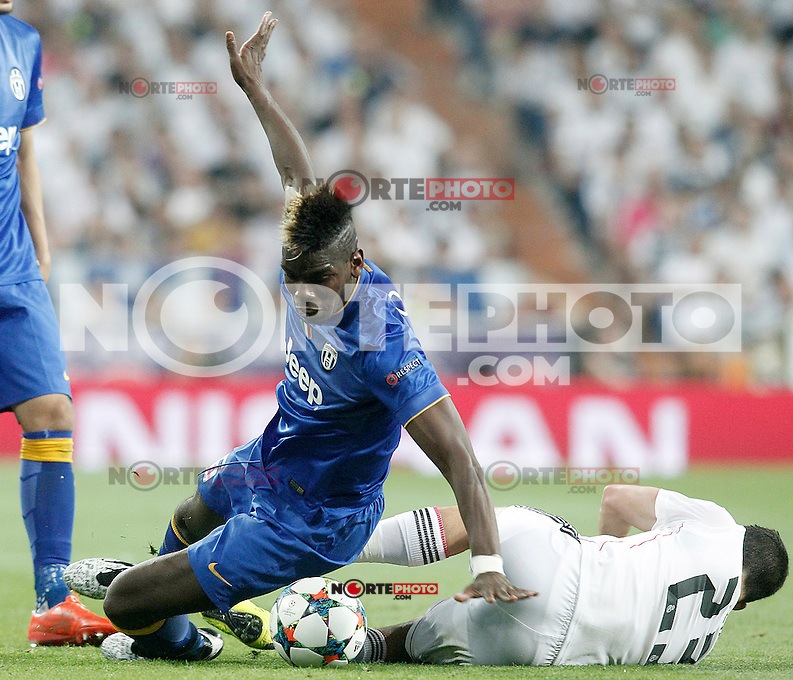 Real Madrid's Isco (r) and Juventus' Paul Pogba during Champions League 2014/2015 Semi-finals 2nd leg match.May 13,2015. (ALTERPHOTOS/Acero) /NortePhoto.COM